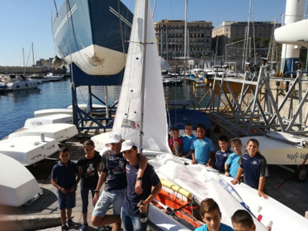 Little wind but a new 420 to celebrate for the Mascalzone Latino Sailing School